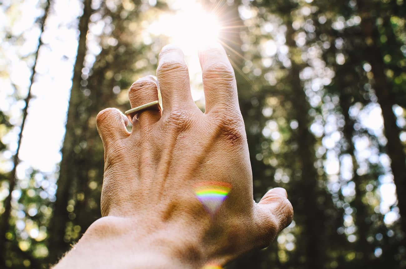 Hands and light to symbolize Reiki energy therapy